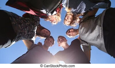 Smiling group of teenage friends in circle - Cheerful...