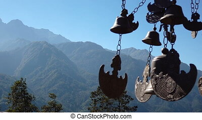 Buddhist bells fluttering in the wind against a background...