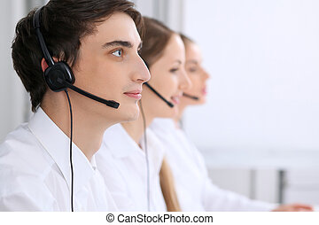Call center. Focus on a man in headset