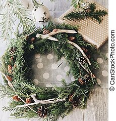 Christmas wreath from fur-tree branches with cones - On the...