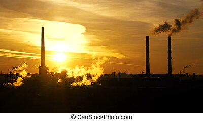 Timelapse video of oil refinery and air pollution at sunset....