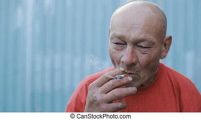Drunk Smoking Rural Man - Drunk homeless smoking man on the...