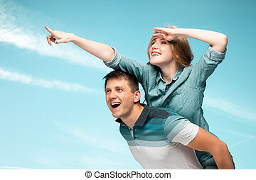 Young couple smiling under blue sky - Young love Couple...