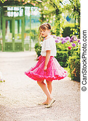 Pretty little 9-10 year old girl playing in beautiful...