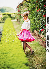 Outdoor portrait of adorable little 9-10 year old little...