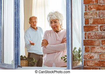 Couple having argument - Elderly couple having argument by...