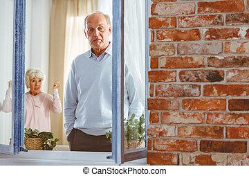 Woman shouting at man - Senior elegant woman shouting at man...