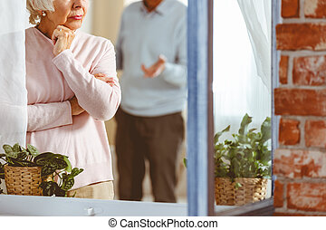 Man and woman arguing - Senior man and woman arguing in...
