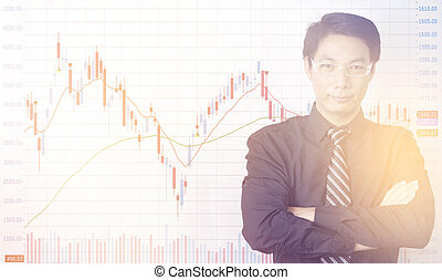 Businessman standing with business charts and graphs