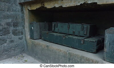 Old bunkers and boxes of ammunition at cannon fort in Cat Ba...