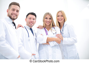 Happy and confident team of doctors posing on camera -...