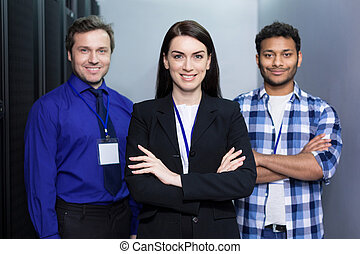 Professional delighted colleagues standing together - Great...