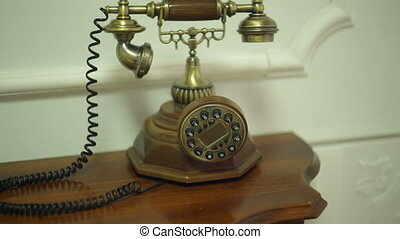 Antique vintage phone on table in hallway - Antique vintage...