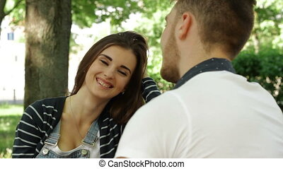 young girl talks to the guy in the Park - pretty young girl...