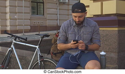 Cyclist has a video chat on the street