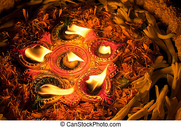 Deepabali - colourful candles are lit in darkness -...