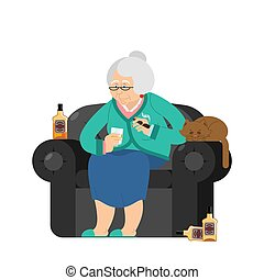 Grandmother drinks alcohol and Smoke cigar. old woman in an armchair with bottle Whiskey. grandma and cat. Brandy and Tequila Glass