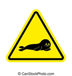 Attention Fur Seal. Caution small sea calf. Yellow triangle road sign