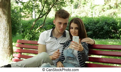 a couple in a relationship makes selfie in the Park on a...