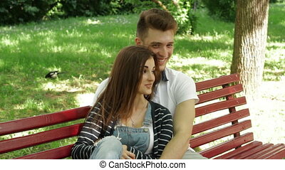 couple hugging and laughing in a relationship in the Park on...