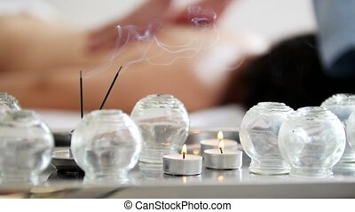 Medical glass cups in the massage room on the background of...