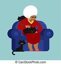 African American Grandmother and cat sitting on chair. granny cat lady. grandma and pet. old woman and animal. gammer and Beast