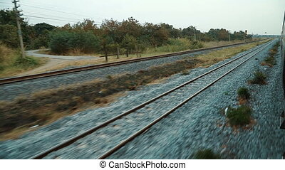 View of railroad tracks from the train window.