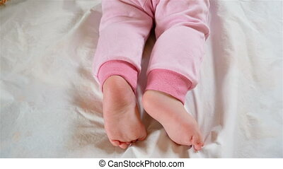 little feet a newborn baby - Two little feet a newborn baby...