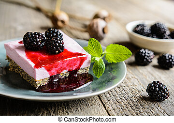 Delicious poppy seed and blackberry cheesecake topped with...