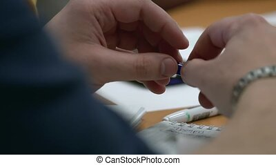 Close-up. A man holds a pencil in my hand and the thrill of...
