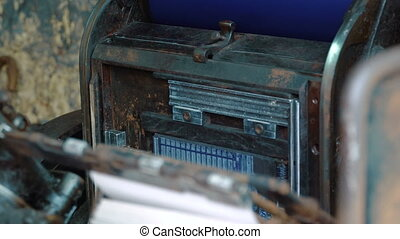 old vintage printing press - Flyers are being printed by old...