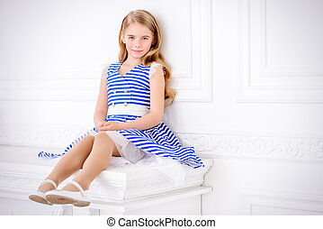 dress for sea holidays - Cute little girl in a beautiful...