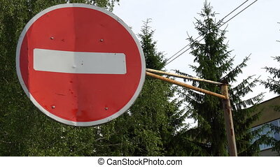 sign no Entry on a background of green trees.