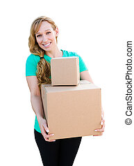 Smiling Young Adult Woman Holding Moving Boxes Isolated On A White Background.