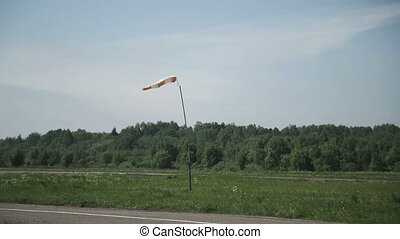 Windsock in stormy condition - A wind gauge on the runway...