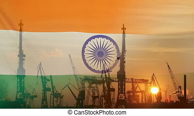 Industrial concept with India flag at sunset, silhouette of...
