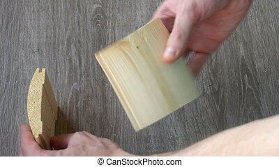 a young man builds a small house of boards.