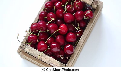 Rotating box of red cherries - Rotating box of dark red...