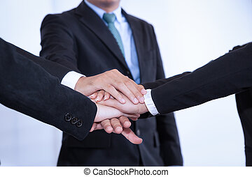 business people join stack hand while meeting in office as...