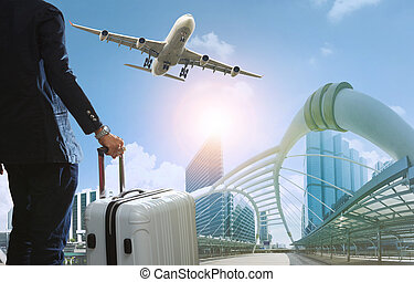 business man and traveling luggage in city life with plane...