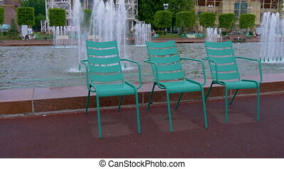 A beautiful resting place in the park near the fountain....