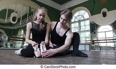 Ballet dancers in the ballet hall - Ballet dancer sitting on...