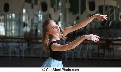 Young ballerina dancing in the ballet hall - Close up young...