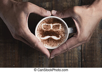 man face in a cup of cappuccino