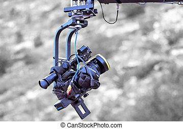 Tv camera recording on a crane, isolated on black and white...