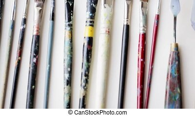 messy palette knives and paintbrushes - art, creativity and...