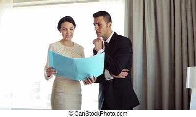 business team with papers working at hotel room - business...