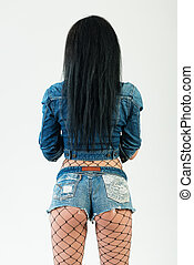 Sexy young stylish hipster girl posing, beautiful ass in...
