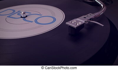 Vinyl player plays vinyl disc with disco cover - 3d...
