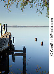 Peaceful waters - Rustic jetty on a zen-like idyllic lake in...